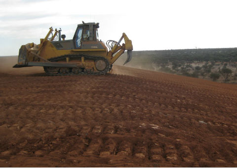 Application of topsoil on a waste rock dump